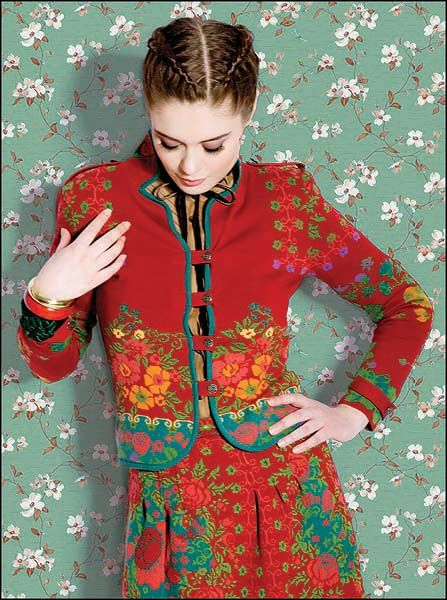 red suit with floral design