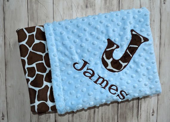 This listing is for 1 Minky Baby Blanket: Blue and Brown Giraffe print minky on one side and Light Blue Minky Dot on the other. This blanket is approx. 29 x 35. It is Perfect for a crib, car seat or stroller. Blankets are zigzag topstitched to increase stability and wear. Each blanket comes wrapped in a satin ribbon with a tag containing care instructions. ***You have the option to PERSONALIZE the time of purchase. At checkout, please leave the following info in the notes to seller Box: 1)…