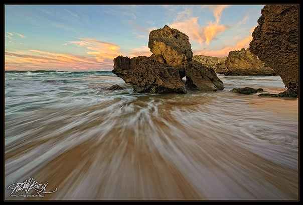 Carriage Rock, a recognisable landmark at Kenton-On-Sea captured at first light with movement in the water by South African fine-art landscape photographer Mitchell Krog. (Copyright Mitchell Krog - All Rights Reserved)