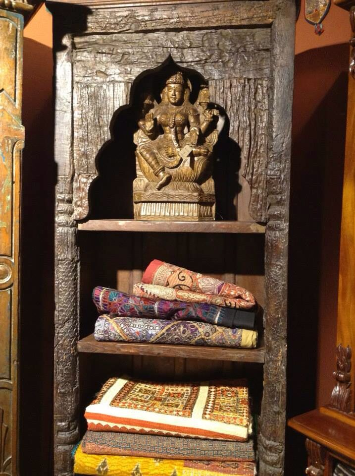 This up-cycled indian timber bookshelf. Hand carved wooden Lakshmi and heavily embroidered Indian textiles.