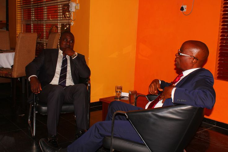 Femi Ipadeola listens attentively as DR Olamitoye emphasizes a point during the recording of Enterprise700 TV interview