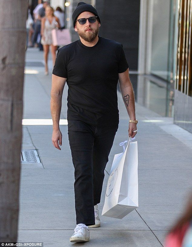 Looking good: Jonah Hill was spotted looking slim and fit during a solo shopping outing to luxury store Prada