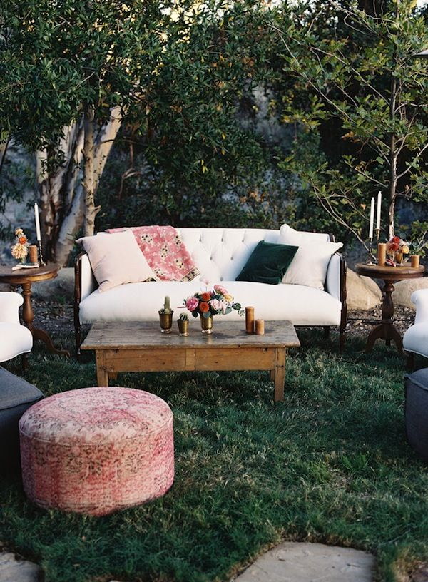 This outdoor seating arrangement is so relaxed and eclectic.