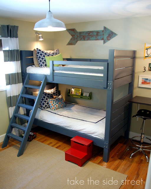 Boys Bedroom with Blue Wood Bunk Beds. Love the small book shelves (ikea spice racks?)