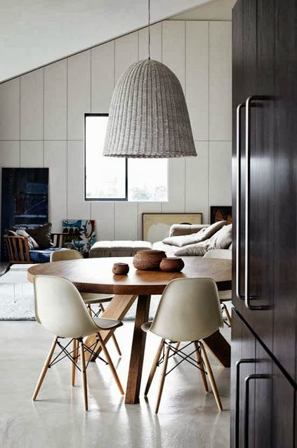 Chalk wicker pendant, round wooden dining table and polished concrete floor. http://www.raftfurniture.co.uk/megan-round-dining-table-natural-teak.html