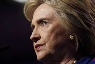 Hillary Clinton pauses during a speech