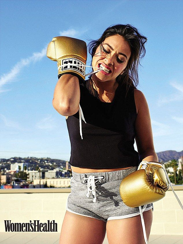 Girl power:  Rodriguez sunk her teeth into the laces of her gold boxing gloves as she mode...
