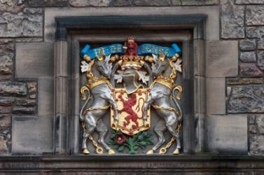 The Scottish coat of arms displayed on the wall of Edinburgh castle. Unicorns Scotlands national animal