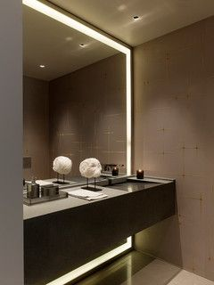"From Shannon. Mirror. What the architect said is ""This is a custom mirror with frosted glass border, set in a custom polished nickel frame (¼"" thick and ¾""). The LED lighting is by LED linear – Vario LED FLEX."""