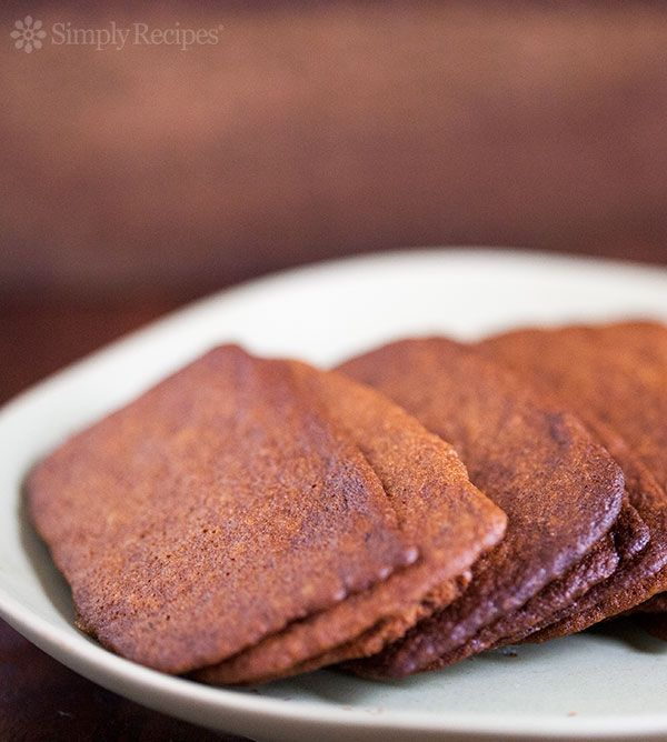 Best Gingersnap Cookies EVER! Ultra-thin gingersnap cookies with molasses and ground ginger, baked until lightly browned and crispy. #ChristmasCookies #Cookie #Gingersnap