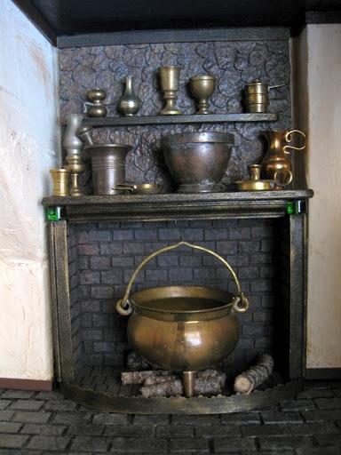 miniature fireplace with cauldron