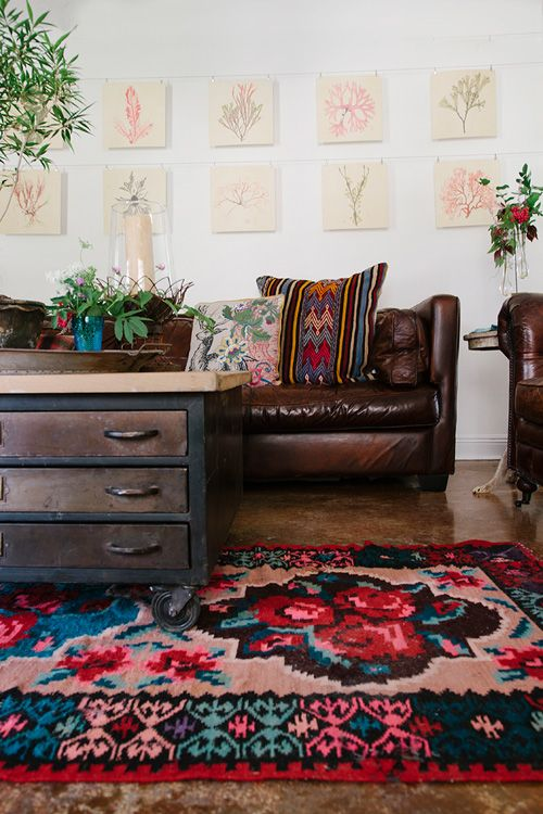 Comfy Living Room With Leather Couches Kilim Cushions And Huge Bright Jewel Tone Fl Rug
