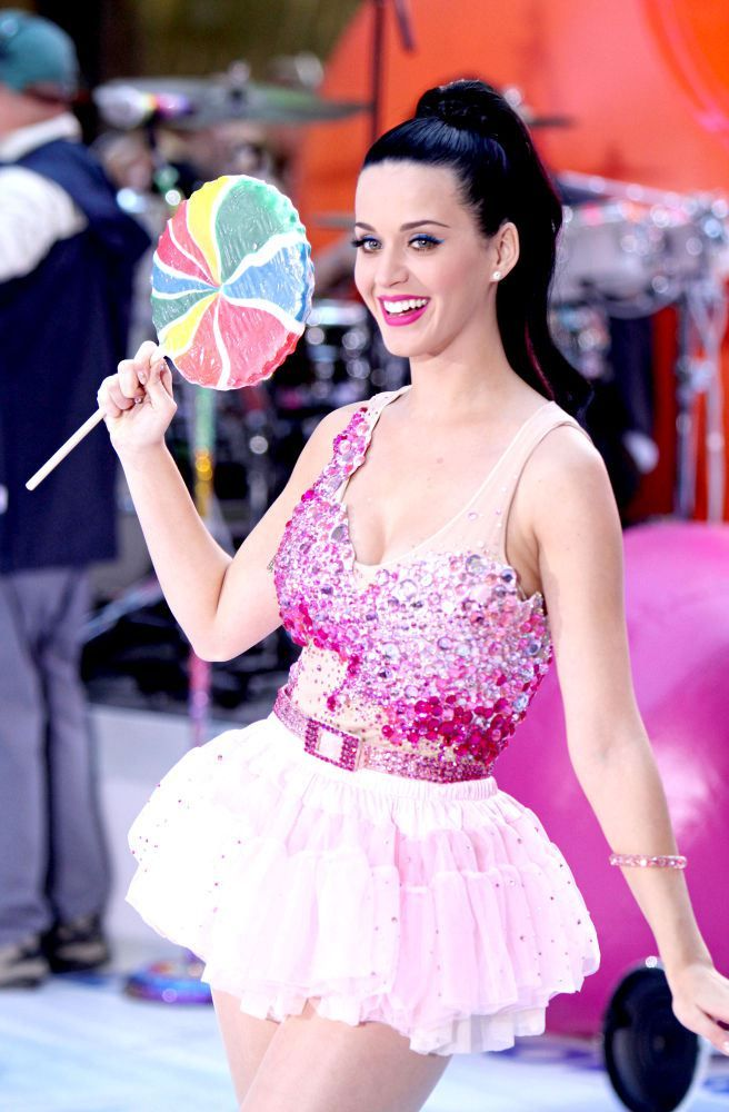 Katy Perry with Candy from our Katy Perry Halloween Costumes post at https://www.merchbar.com/blog/2015/09/22/hot-katy-perry-costumes-you-can-buy-or-make-for-halloween-2015/