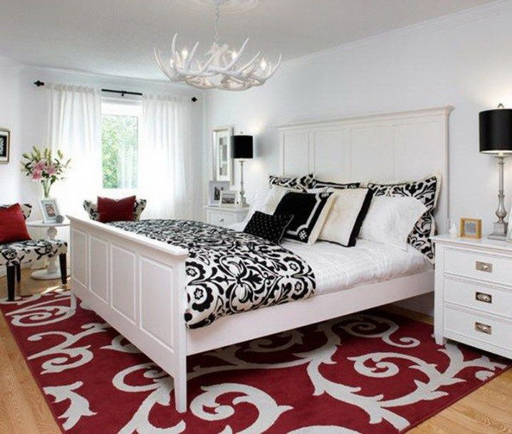 Love the design of this red rug. Totally elevates this black and white  bedroom to a new level.