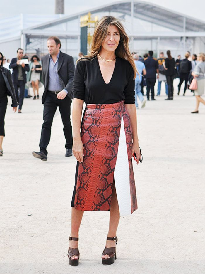 Nina Garcia in a black shirt and red snake print skirt: