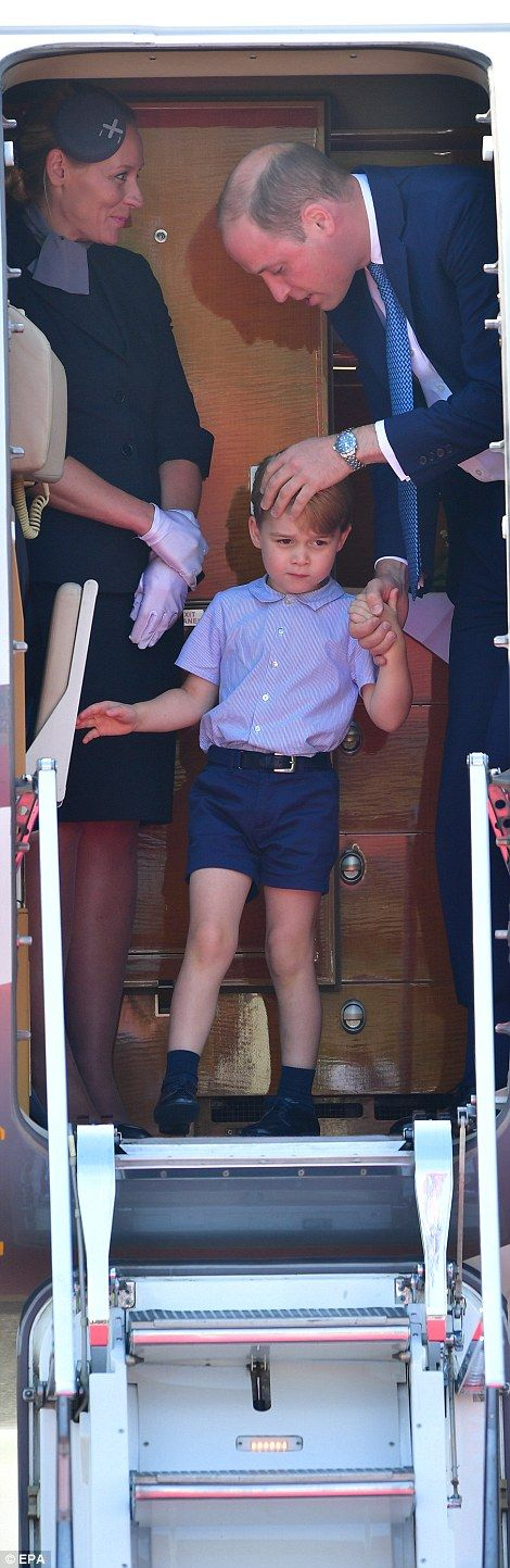 Doting father Prince William gave his son a reassuring pat on the head before they exited ...