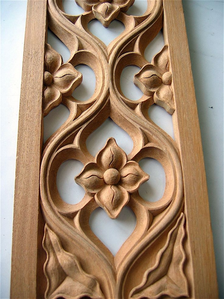 Typical Gothic tracery molding hand carved in wood