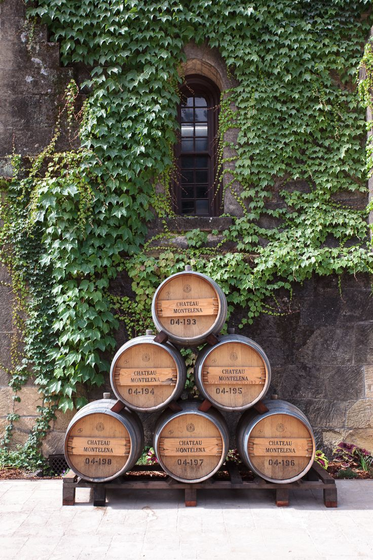Wine barrel stack at Chateau Montelena in St Helena, Napa https://boulesse.com/en