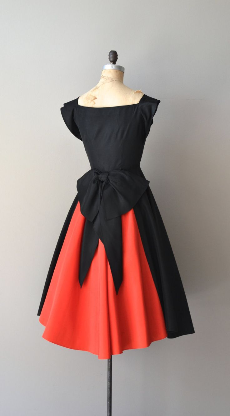 Vintage 1950s black rayon taffeta party dress with true red pleated crumb-catcher bodice, cap sleeves, fitted waist, very large back bow and metal side zipper.