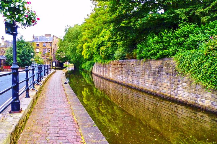 Bridge 1a carries Tower Hill road over the Rochdale Canal at Sowerby Bridge.For a long time the canal ended at the bridge and was only re opened in 1996 after having been closed and in filled since the 1950s. More of my pictures and information can be seen at, www.colingreenphotography.blogspot.co.uk