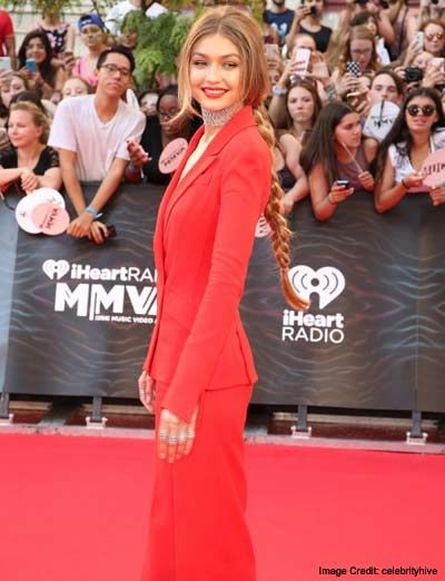 Gigi Hadid:  Gigi Hadid Hair    She's a model and she needs to have long hair for the versatility it offers to her looks. We absolutely loved her red tailored suit ensemble at the iHeartRadio Much Music Video Awards back in June. Everybody spotted her glittery choker, but then there was also that long, braided hair that extended up to her waist. Again, Gigi delivers.