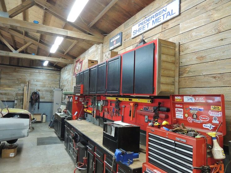 Really like the looks of this garage. Natural wood look, with a nice wall of cabinetry and tools.