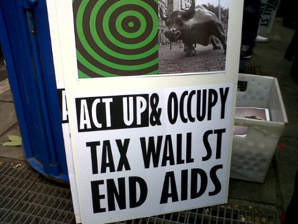 @carriem213: There are millions of these rad signs being passed out. Tax Wall St! End AIDS! #ActUp25 #owsWall St, Tax Wall