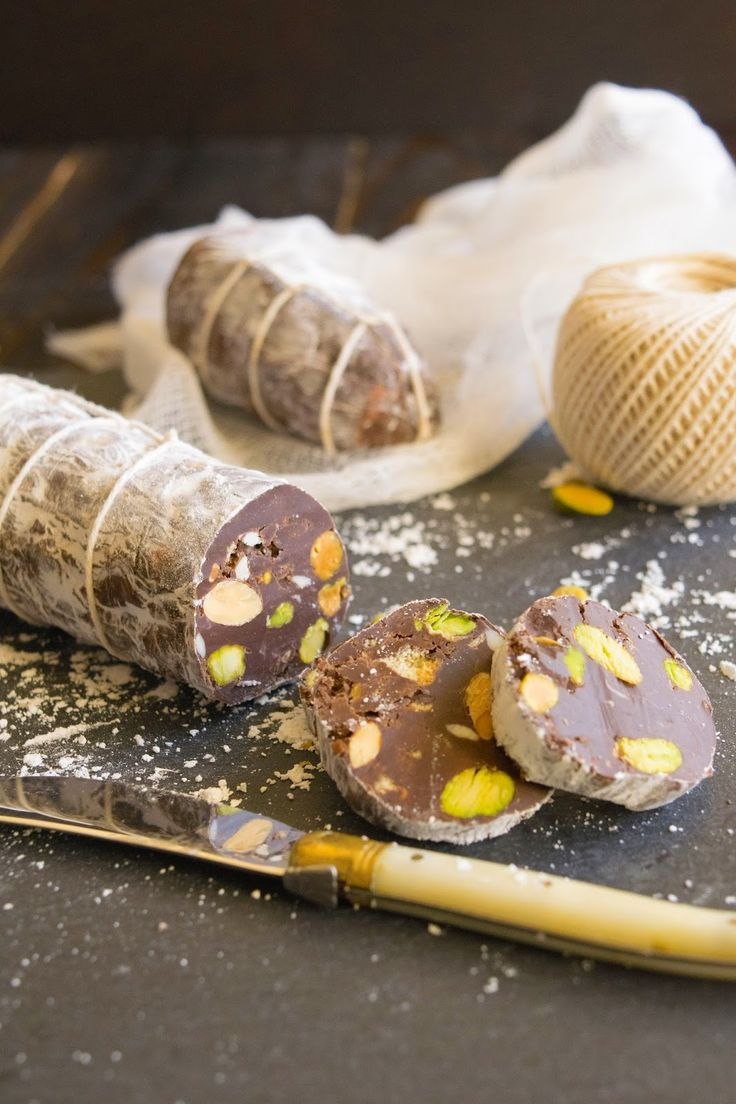 Chocolate salami, a popular Italian dessert. Orange infused dark chocolate with nuts, white chocolate and cookies.