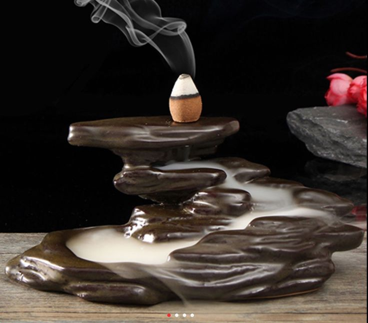 Rock formation backflow incense burner.  Instead of rising the smoke trickles down filling the pools and overflowing into a lower pool.  So relaxing to watch.