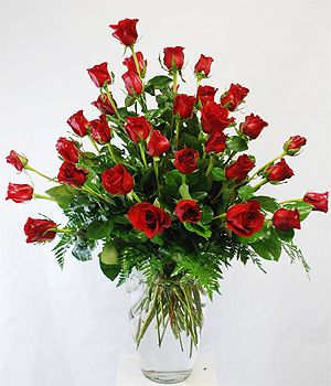 Triple Dozen Roses - A Triple Dozen Fresh Long Stem Roses designed with assorted ferns arranged in a classic clear vase.