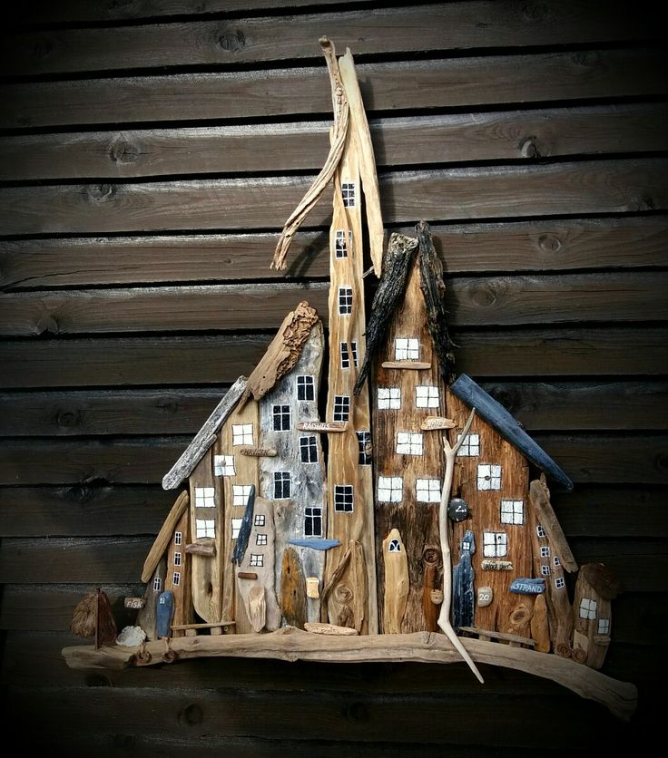 Big driftwood town/houses, with sailboat.