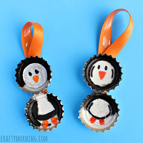 Bottle Cap Penguins - Make an adorable bottle cap penguin craft with your kids! It's a cheap christmas ornament idea for them to make as gifts.