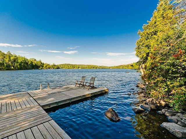 Private peninsula surrounded by water, Gated property, Over 1,000 lin.ft.(300mt) on the shores of Lac St-Victor pristine clear head lake with speckled trout. Also private lake within the property, All exterior walkways and stairs made of natural sandstone,