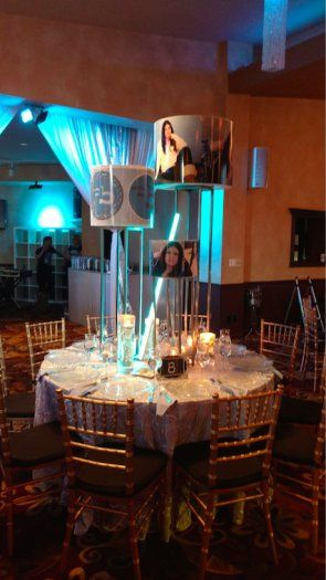 Bat Mitzvah Centerpieces | Bat Mitzvah Pictures | Elegant Bat Mitzvah  These Bat Mitzvah centerpieces were customized with pictures from the earlier photo shoot! Courtesy of Lighter Than Air Events.
