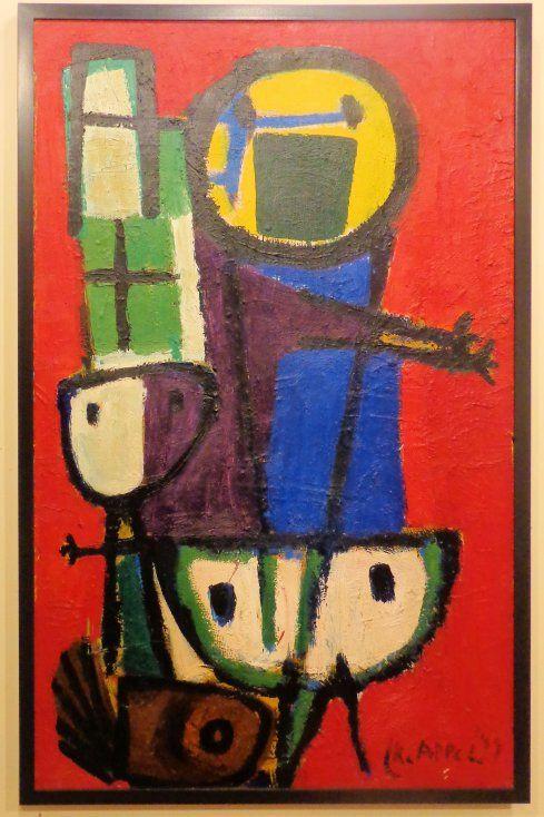 Vragende kinderen door Karel Appel uit 1949. Tijdens een treinreis door het overwonnen Duitsland werd Karel Appel getroffen door de blik van een groepje hongerige kinderen. Het beeld liet hem niet los. Hij maakte vele schilderijen en collages met priemende kinderogen.