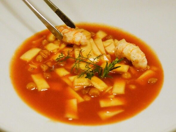 Pasta soup with chikpeas and porcini mushrooms, with prawns and clams