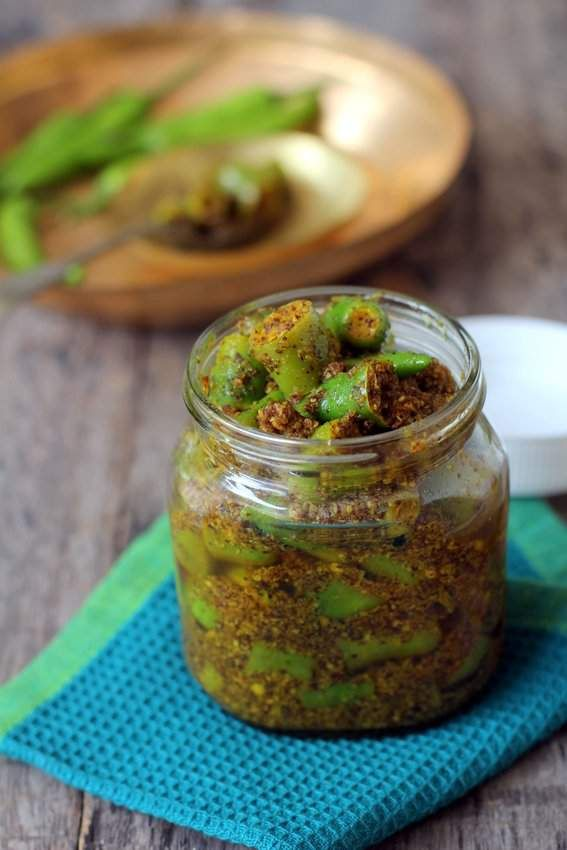 Green chilli pickle recipe is a tasty, instant North Indian style pickle made with fresh long green chillis, Indian spices like mustard, fenugreek and mustard oil