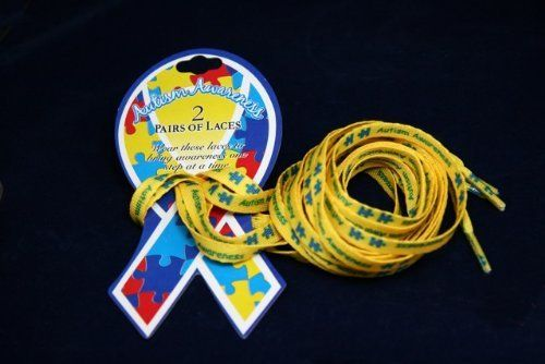 """Autism Ribbon Shoe Laces (1 Card with 2 Pairs of Shoe Laces) by Fundraising For A Cause. $2.50. Our autism ribbon shoe laces are a perfect way to show your support. Each card says """"Wear these laces to bring awareness one step at a time"""".  The shoe laces have puzzle pieces and the words """"Autism Awareness"""" on them. Each shoe lace is 42 inches long and a bit more than 1/4 inch wide."""