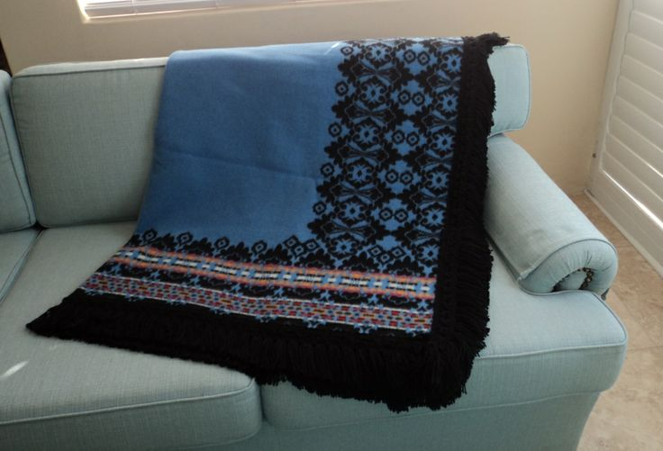Europe meets Africa. Light blue Motsoako with fringes -http://annmack.co.za/store/products/category/basotho-blankets/