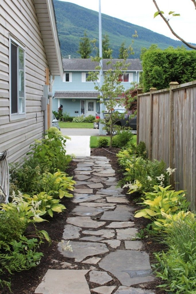 Lovely walk way. 12 beautiful yellow hostas along with ... on Side Yard Walkway Ideas  id=48089