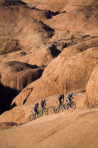 group mountain biking, Moab, Utah    http://www.fastbikeparts.ch/
