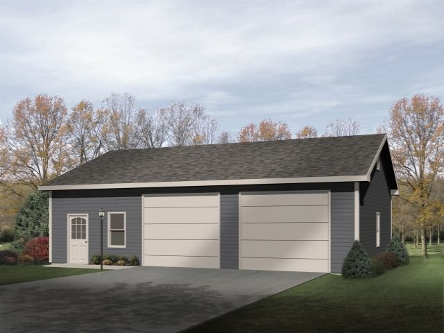 Extra large two car garage has enough room for a work shop and additional storage.