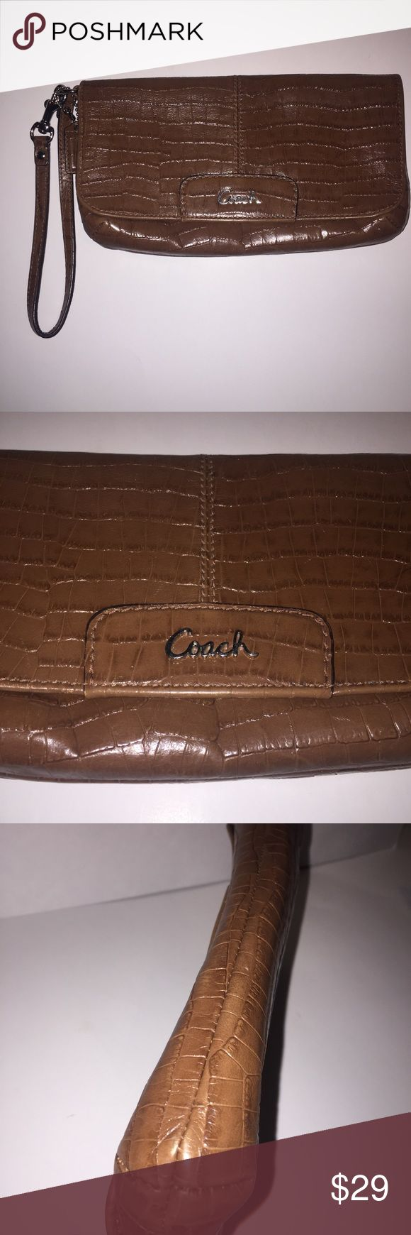 Coach Wristlet Clutch Brown Embossed Leather Coach Women's Wristlet Brown embossed leather Pink inside 1 large compartment with 1 side pocket Coach Bags Clutches & Wristlets