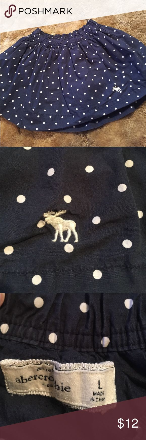 Girls bundle! 3 bottoms abercrombie kids navy and white polka dot skirt! In great condition. It has a navy blue ruffle lining. Very stretchy elastic waistband.       Gap kids denim shorts with polka dots, cuffed hem. Children's Place pants. Purple and blue floral pattern. All items are in excellent condition! GAP Bottoms Skirts