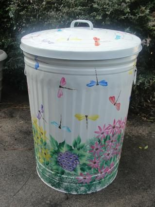 Hand-painted trash cans...cute idea for storing small garden tools and such
