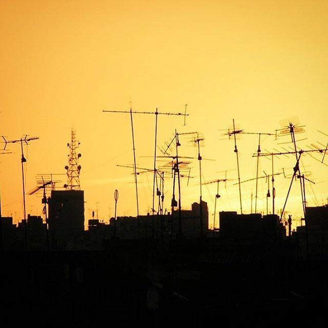 #silhouette of #houses #buildings in #capital #beirut #roofs #antenna #tv #tower #yellow #black #organized #mess #loveit #bld #house #home #instalike #lebanon #instagood #instamood #sunset #instadaily #instapic #photo credited to shant.me - yellow sky