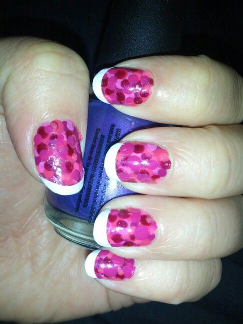 Pink polka dots with white tips.