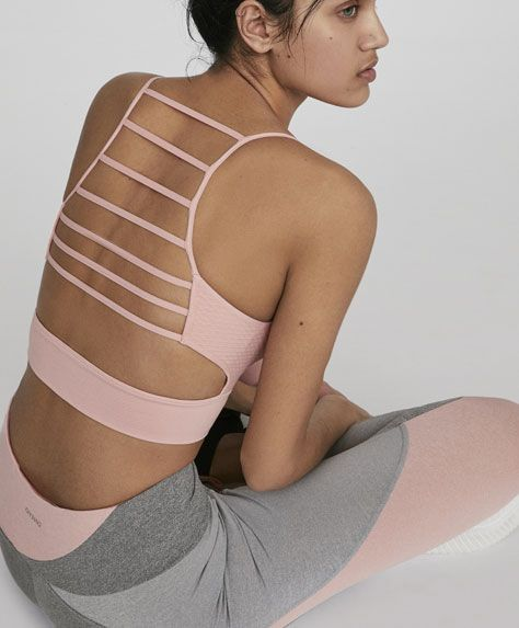 Sports bra with strappy back, 19.99€ - Low-support sports top featuring back straps. - Find more trends in women fashion at Oysho .
