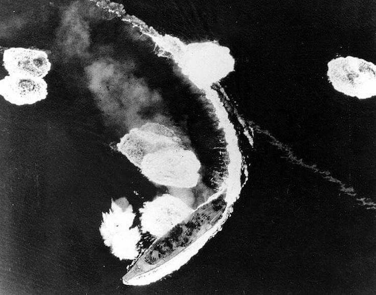 Japanese battleship Yamato maneuvers while under heavy air attack by Task Force 58 planes in the Inland Sea, 19 March 1945. She was not seriously damaged in these attacks. Photographed from a USS Hornet (CV-12) plane. Official U.S. Navy Photograph, now in the collections of the National Archives.