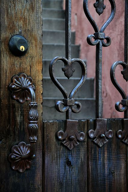 Wrought iron heart exterior door. If I have to have bars on my door, I'd hope they would look like this.